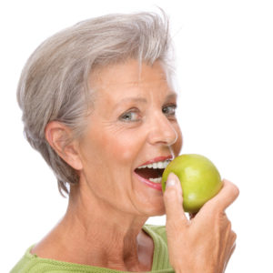 woman preparing to bite into apple
