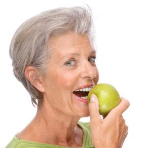 woman preparing to bite into apple